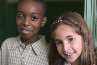 Two Elementary students smiling